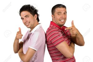 4963301-Two-cool-guys-pointing-and-give-thumbs-up-same-time-and-standing-back-to-back-smiling-and-facing-cam-Stock-Photo
